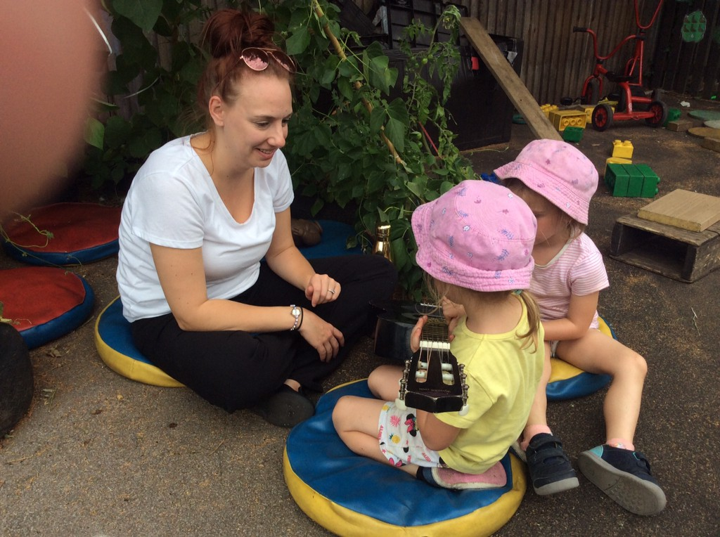 Key person with children at Ashbourne Day Nurseries at Swanbourne