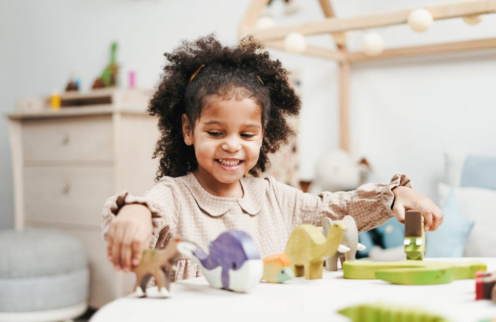 girl playing with toys in nursery